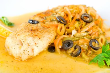 Bass escalope with pine nuts and black olives