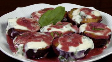 Roasted Plums Topped with Basil Yogurt Sauce
